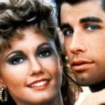 """In celebration of 'Grease''s 40th anniversary, we take a look at what made a Broadway musical about teenage love """"down in the sand"""" such a huge success."""