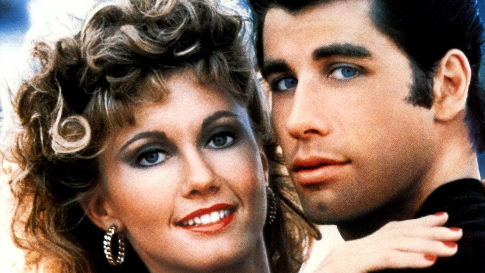 "In celebration of 'Grease''s 40th anniversary, we take a look at what made a Broadway musical about teenage love ""down in the sand"" such a huge success."
