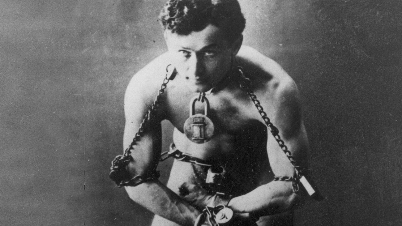 Erik Weisz, known by his stage name Harry Houdini, wowed audiences with his illusions & insane stunts. Here's what we know about his strange death.
