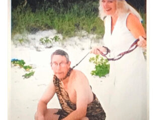 Carole Baskin's wedding photo is obviously unusual. Poor Howard doesn't look like he's having fun being on a leash in a caveman costume.