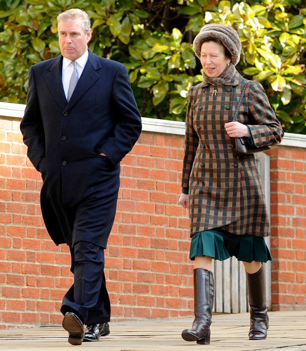 Princess Anne has taken up more royal duties in the wake of Prince Andrew's scandal. Find out how the royal family is weathering through these tough times.