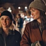 Kristen Stewart is starring in a queer Christmas romcom movie. Here's everything to know about the exciting holiday flick 'Happiest Season'.
