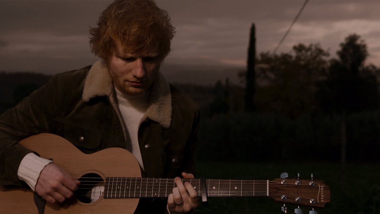"""Ed Sheeran surprised fans with a new single for Christmas. Listen to the """"Happier"""" singer perform his latest song."""