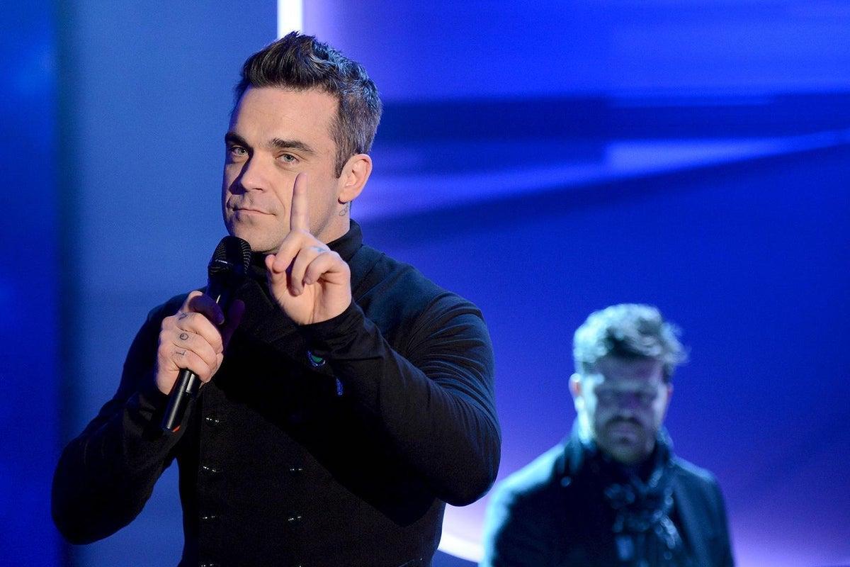 ¡Ya tenemos un himno para nuestra Navidad pandémica! Checa la nueva canción de Robbie Williams sobre lo mucho que apestó el 2020.