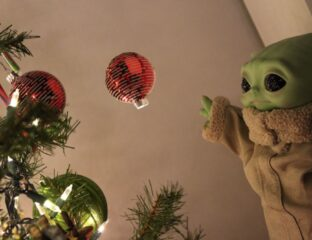 The smiling baby Yoda is the hottest Christmas tree topper in 2020. See how 'Star Wars' fans celebrate the holiday season with baby 'Grogu'.