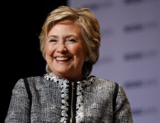 Hillary Clinton is penning a new book, and it's going to be a mystery. Dive into the synopsis of Clinton's new project right here.
