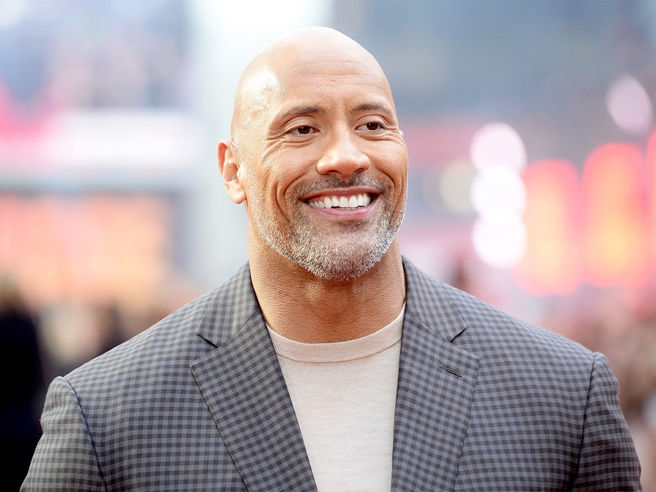 Dwayne 'The Rock' Johnson is a massive movie star, both literally and figuratively. Find out how tall the celebrity is.
