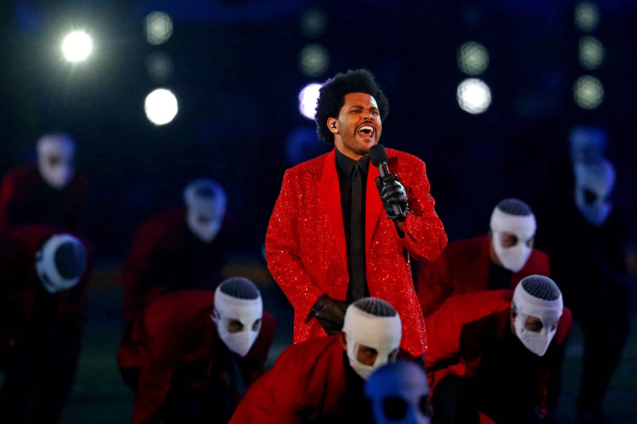 """""""Blinding Lights"""" singer The Weeknd has had a steady stay in the headlines over the past year. Why did his dancers wear face bandages?"""