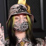 """Billie Eilish apologized to Megan Thee Stallion after winning """"Record of the Year"""" at the 2021 Grammys. Learn why she felt like she had to apologize."""