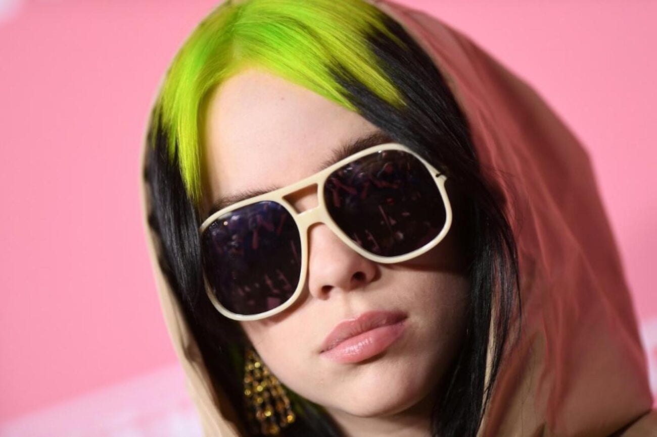 Billie Eilish gets real about her past body struggles and how she feels about the tank top photo. Read on to hear the singer's thoughts.