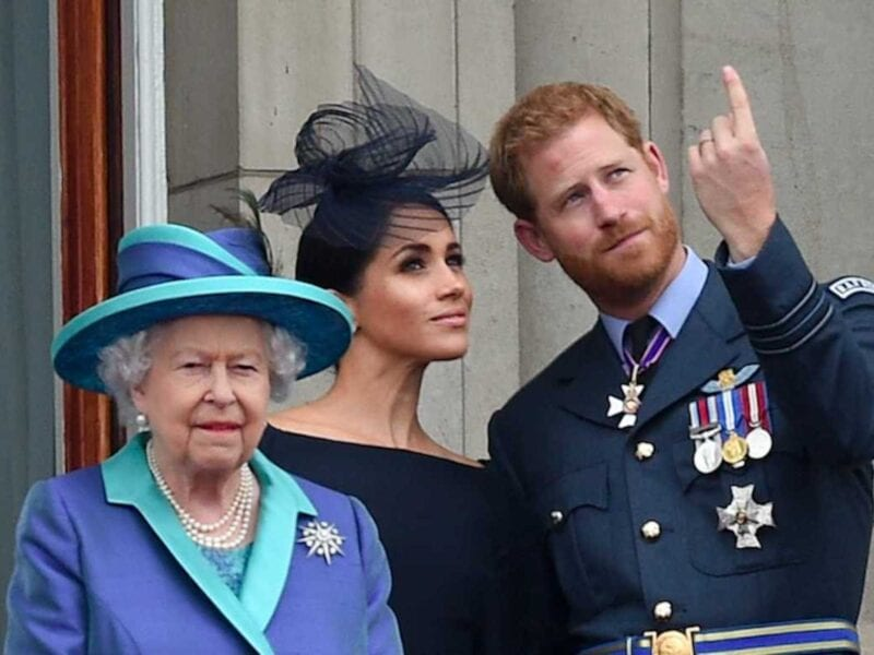 """The tension between Prince Harry and Meghan Markle with the rest of the royal family has been well documented, especially after their interview with Oprah Winfrey on CBS. In fact, the only people the couple appeared to be on good terms with was with Harry's grandparents, Queen Elizabeth II and the late Prince Philip. When his grandfather died in April, Prince Harry naturally made the trip to pay his respects. But what about Meghan Markle? Well, sources say that she, naturally, wanted to go to support her husband because, again, his grandfather just died. As we all know, however, Prince Harry and Meghan Markle are expecting their second child, a daughter, in just a short while. Now, it's difficult for a pregnant woman to travel under the best of circumstances. But during COVID-19? Yeah, forget it. Prince Harry had to travel alone to Prince Philip's funeral while Meghan stayed with their young son Archie back in California. Due to her advanced stage of pregnancy, doctors could not give her permission to travel abroad for the service. Which, of course, is understandable because she's pregnant and we're in a global pandemic. Prince Harry had to quarantine ahead of the service. What did Queen Elizabeth think of this? Unlike most of the media attacks against Prince Harry and Meghan Markle, Queen Elizabeth was understanding of the circumstances. Meghan is, after all, pregnant, which, yes, we will keep pointing out because, of course, she couldn't travel with the advance stage of her pregnancy. It just makes sense because the health & safety of mother & infant are important at this stage. A Californian source told People on April 13th, """"It was always a given that Harry would return to England for his grandfather's passing."""" The source added that both Prince Harry and Meghan were in contact with Queen Elizabeth after Prince Philip's death where """"Meghan expressed condolences. The Queen understands why she can't travel at the moment."""" Now, while the rest of the royal family se"""